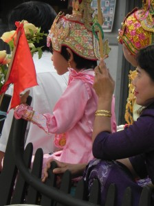 Little girl in initiation procession (Bagan, April 2012)