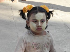 Little girl with Thanaka to protect her from the sun's rays