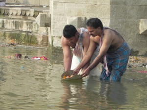 Making an offering to Mother Ganges, Varanasi