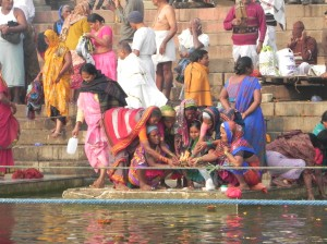 Women Pilgrims praying to Mother Ganges